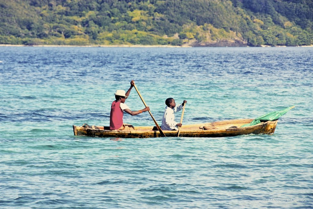 A couple of garifuna boys with a canoe