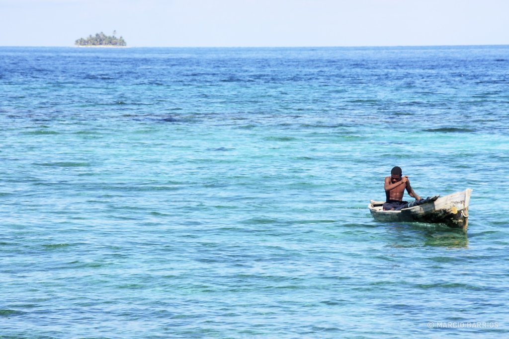 Garifuna boy with his canoe