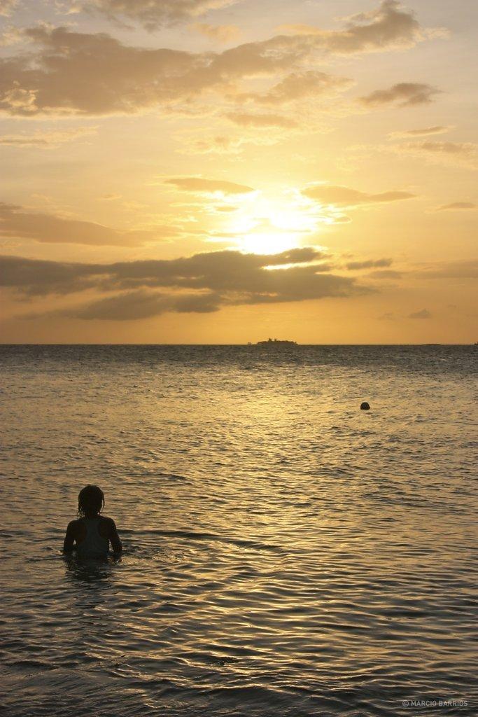Garifuna boy enjoying the sunset in Chachauate