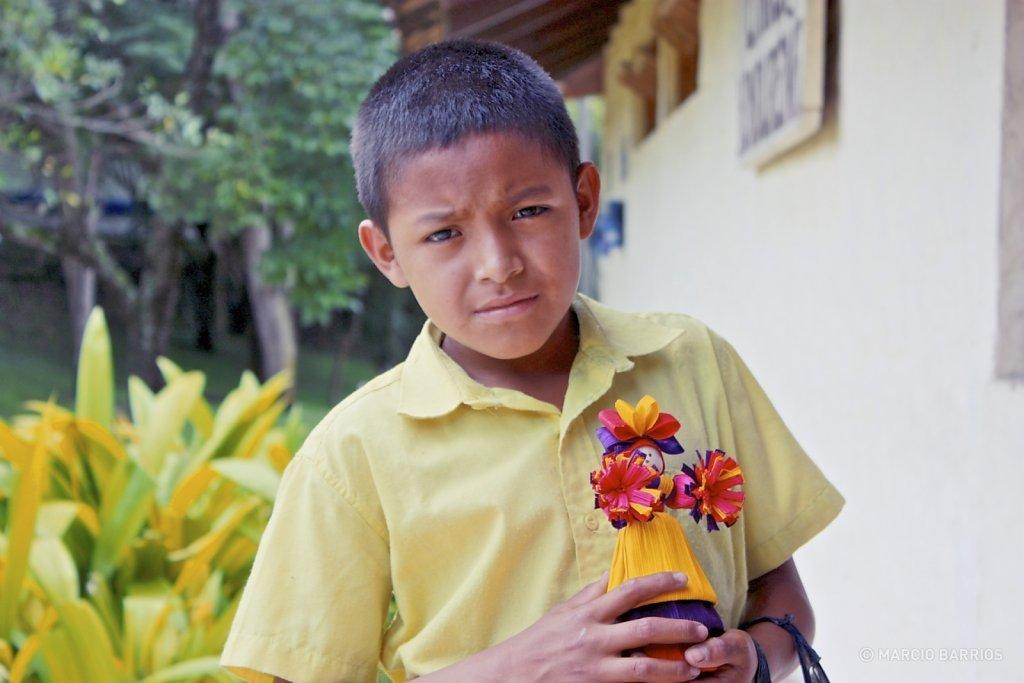 Mayan boy selling typical handmade dolls